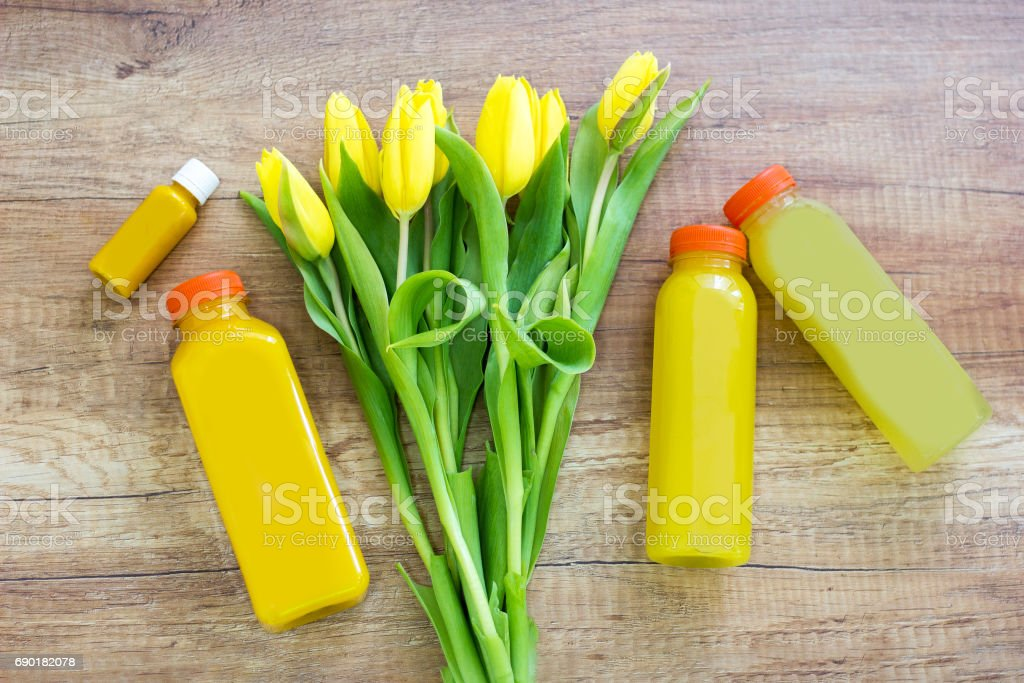 Orange juices and tulip flowers stock photo