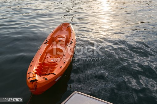 Orange kayak on the sea-Travel Concept