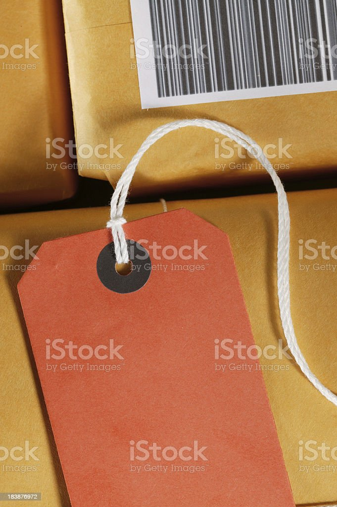 studio shot of packages for shipping;note that the bar code is feak...