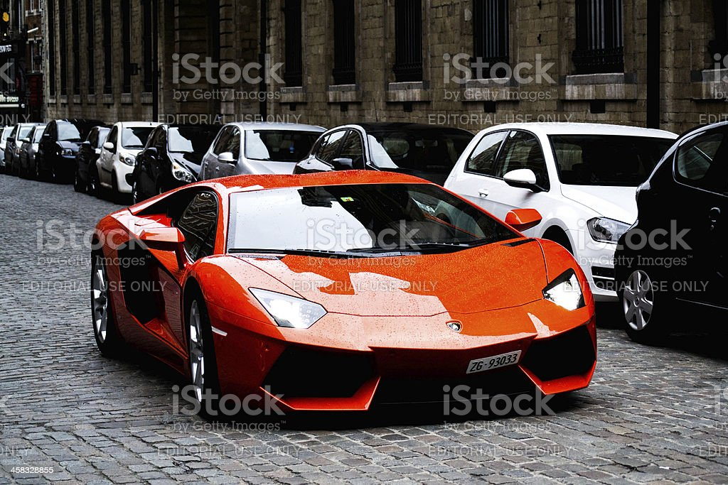 Orange Lamborghini aventador side stock photo