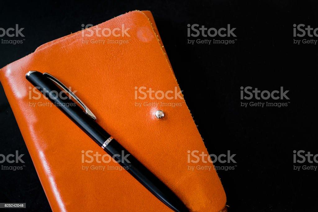 Orange Leather Notebook with Luxury Pen stock photo