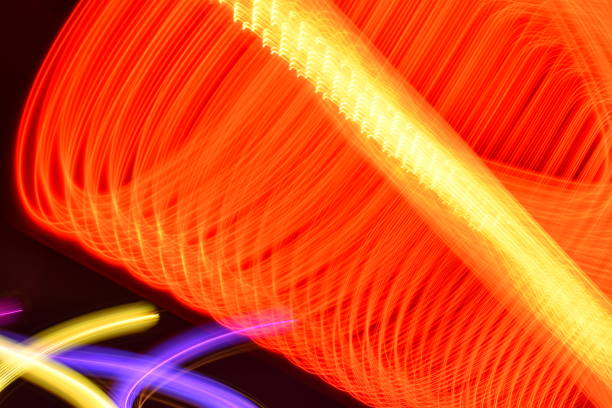 orange led light trails with purple, gold and berry light grid trails - steven harrie stock photos and pictures