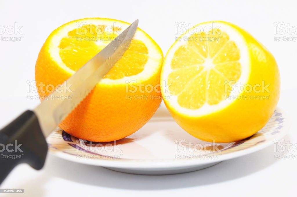Orange lemon and knife isolated stock photo