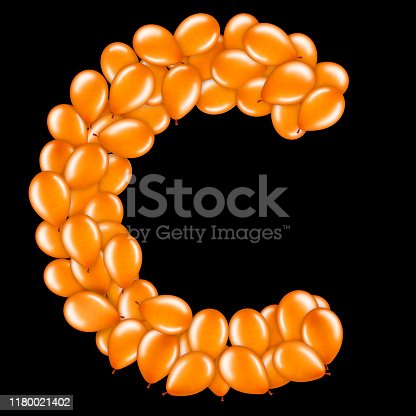 istock Orange letter C from helium balloons part of English alphabet. 1180021402