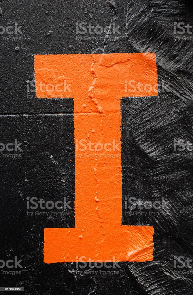 Orange Letter I on black stock photo