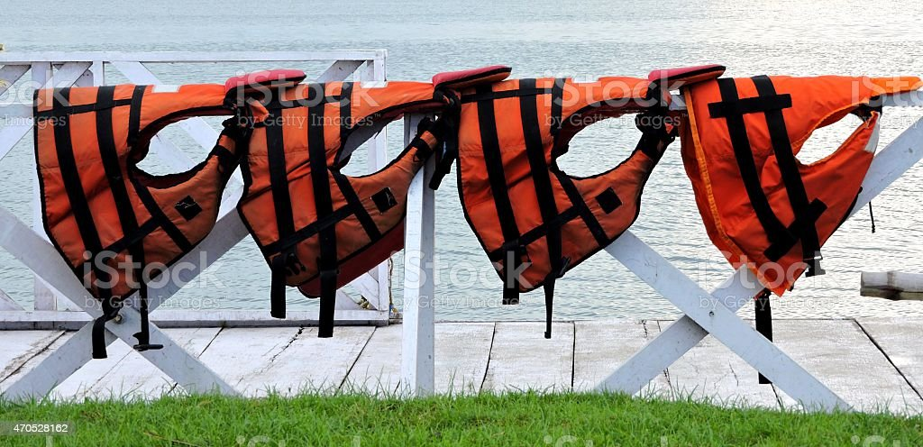 Orange Life Jackets In a Row stock photo