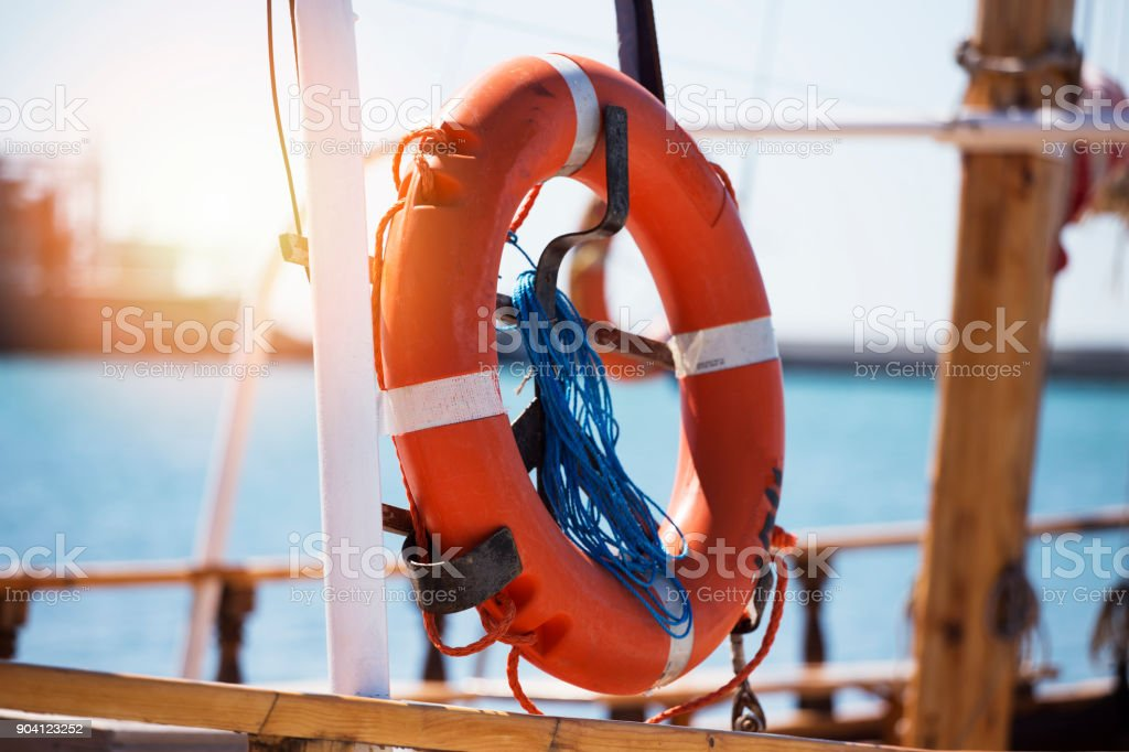 Orange Life Preserver-Ring stock photo
