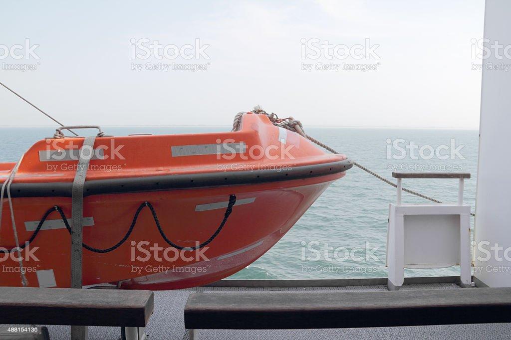 orange lifeboat stock photo