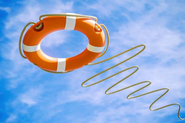 orange rettungsring auf himmelshintergrund. heil-konzept. - sos einzelwort stock-fotos und bilder