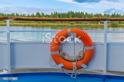 Orange lifebuoy on the ship - travel technology background