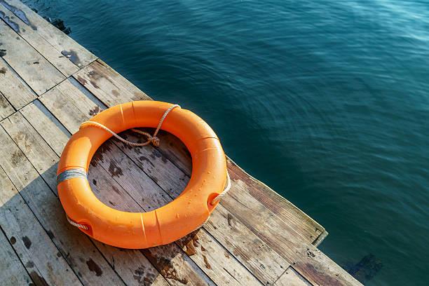 Orange lifebuoy,All Water rescue emergency equipment. stock photo