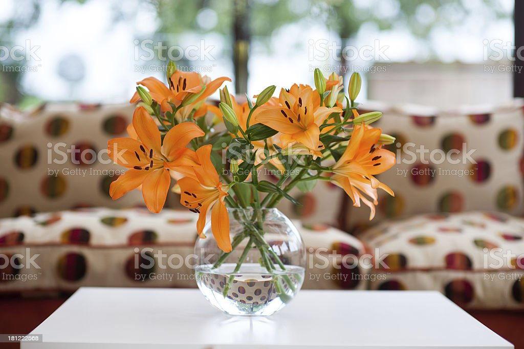 orange lilies in a vase royalty-free stock photo