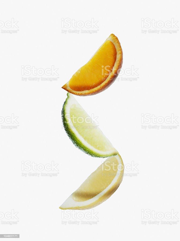 Orange, lime and lemon wedges stock photo