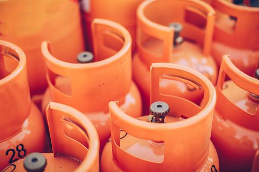 Group of orange LPG tanks, no people.