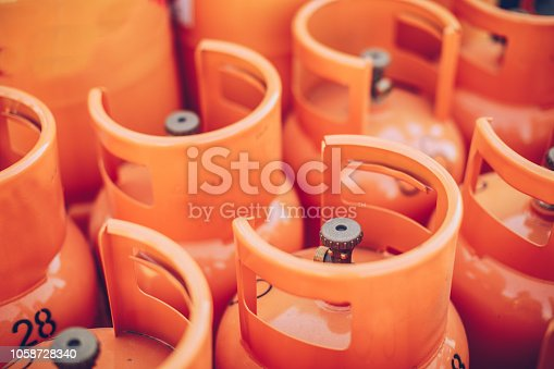 Group of orange LPG tanks, no people.