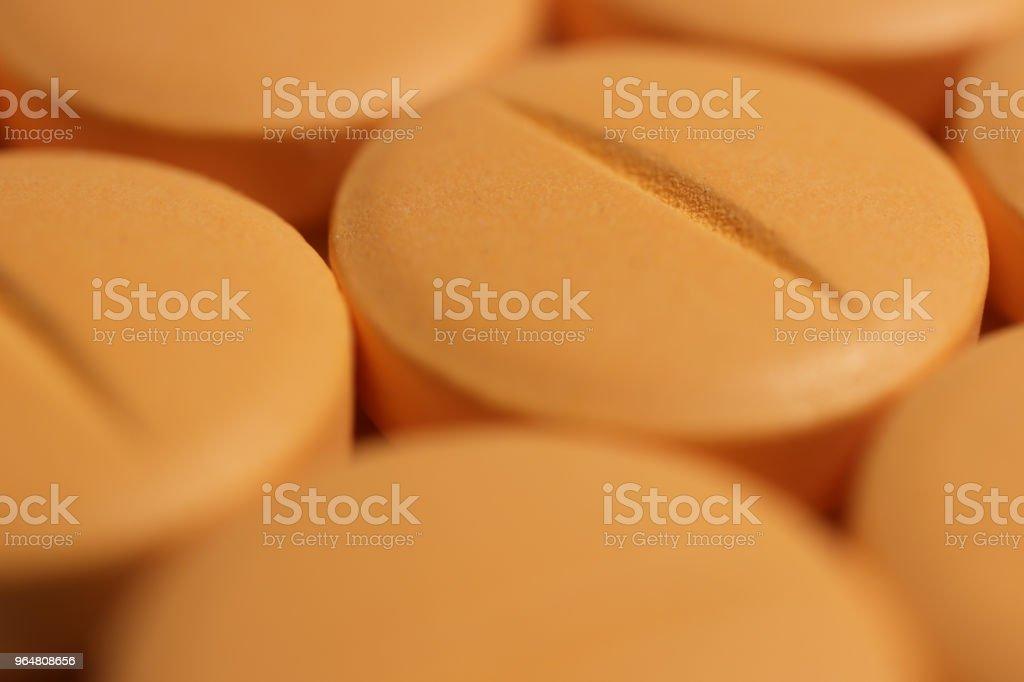 Orange Medicine Tablets. Pharmacy Pills Background. Macro Closeup. royalty-free stock photo