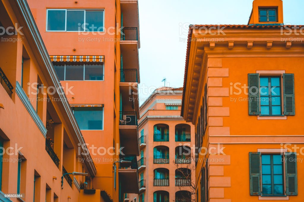 orange mediterranian houses in a city stock photo