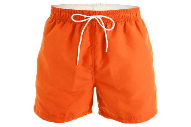 Orange men shorts for swimming Orange men shorts for swimming isolated on white background shorts stock pictures, royalty-free photos & images