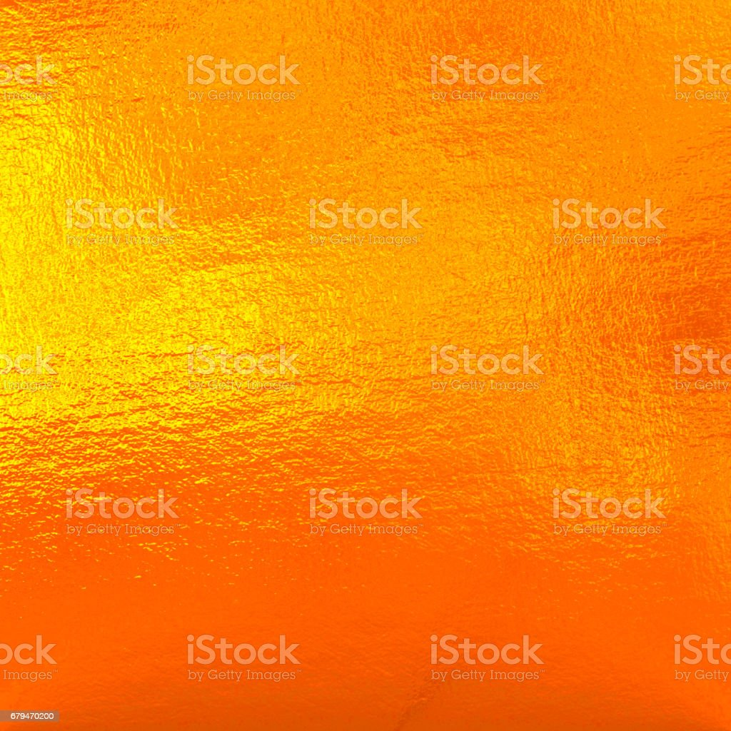 Orange metal background, color foil royalty-free stock photo