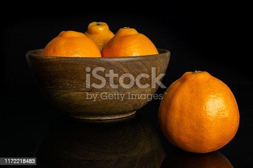 istock Orange minneola tangelo isolated on black glass 1172218483