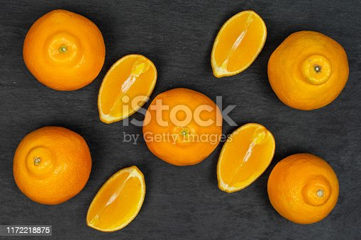 istock Orange minneola tangelo on grey stone 1172218875