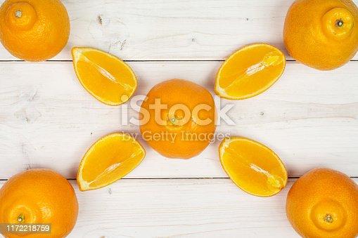 istock Orange minneola tangelo on grey wood 1172218759