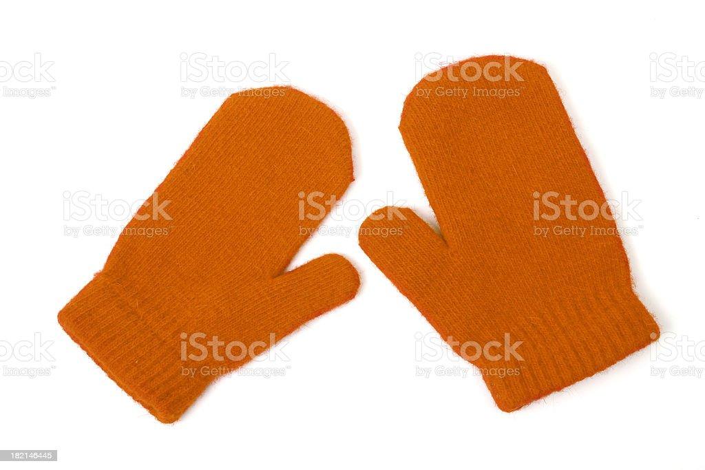 Orange mittens on white stock photo