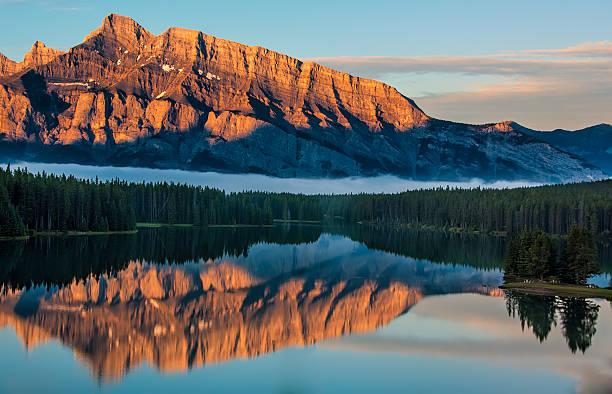 Orange Mountain Reflection in Lake Minnewanka stock photo
