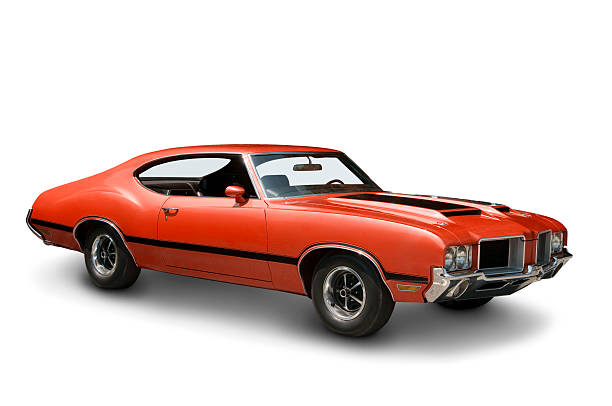 orange oldsmobile 442 against a plain white backdrop - classic cars stock photos and pictures
