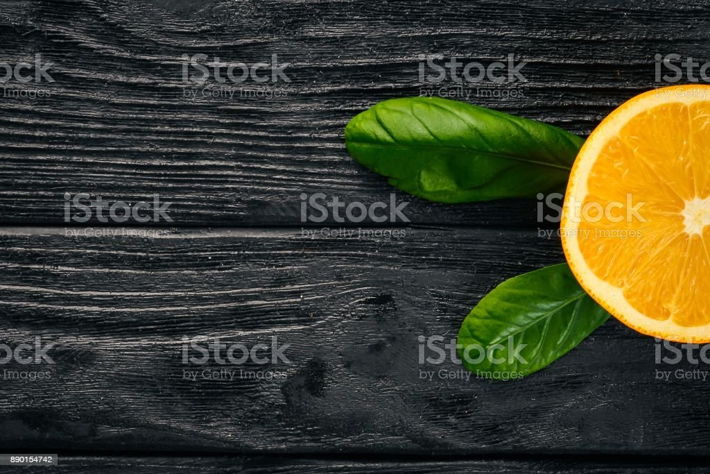 Orange on a wooden background. Top view. Free space for text. stock photo