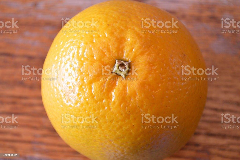 Orange on wood table, closeup stock photo