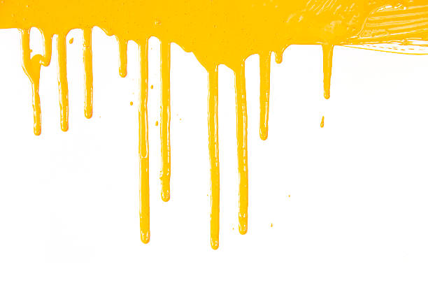 Orange paint  dripping / isolated on white / real photo stock photo