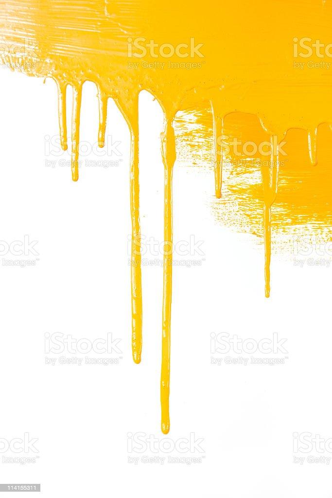 Orange paint  flows / isolated on white background / real photo stock photo