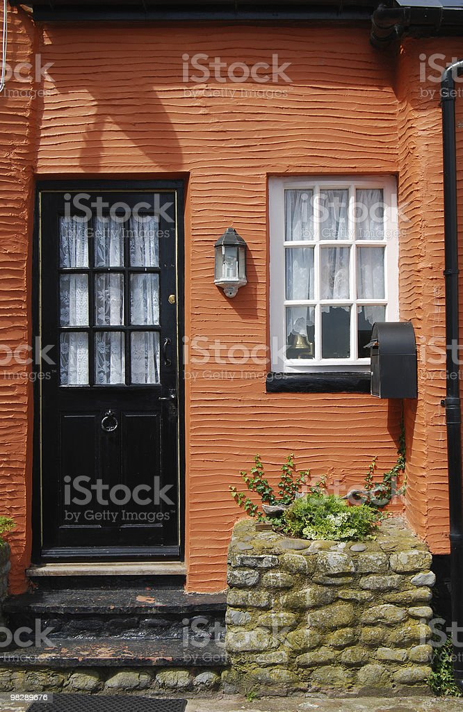 Orange painted Cottage at Watchet. Somerset. England royalty-free stock photo