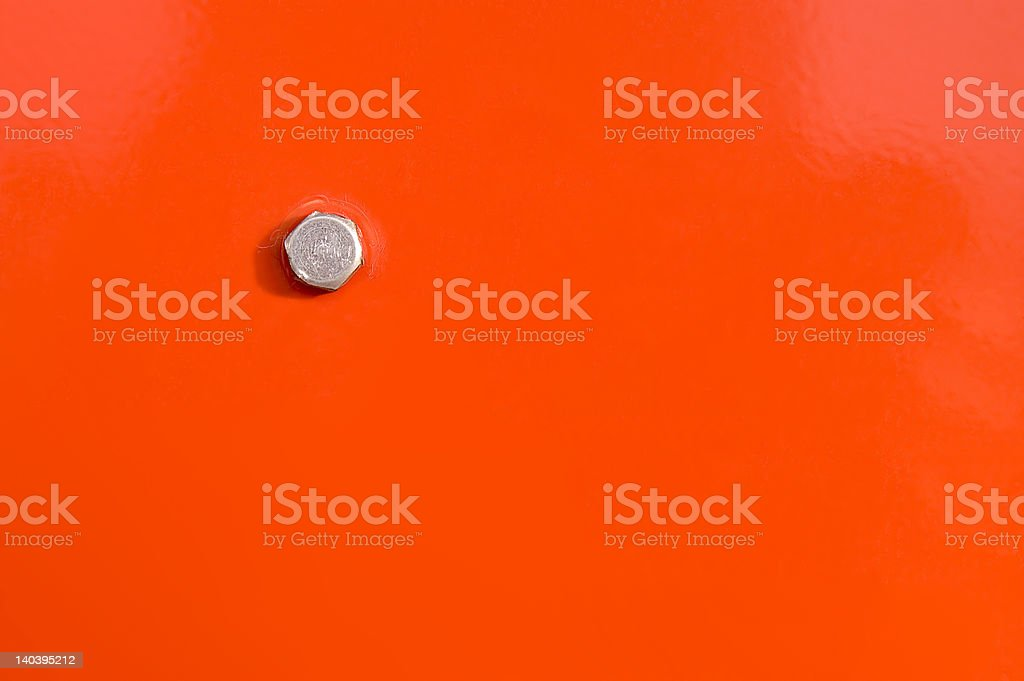 Orange panel and bolt head royalty-free stock photo