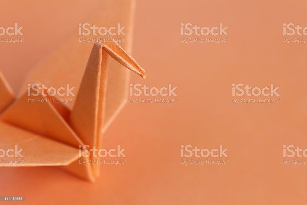 Orange paper bird stock photo