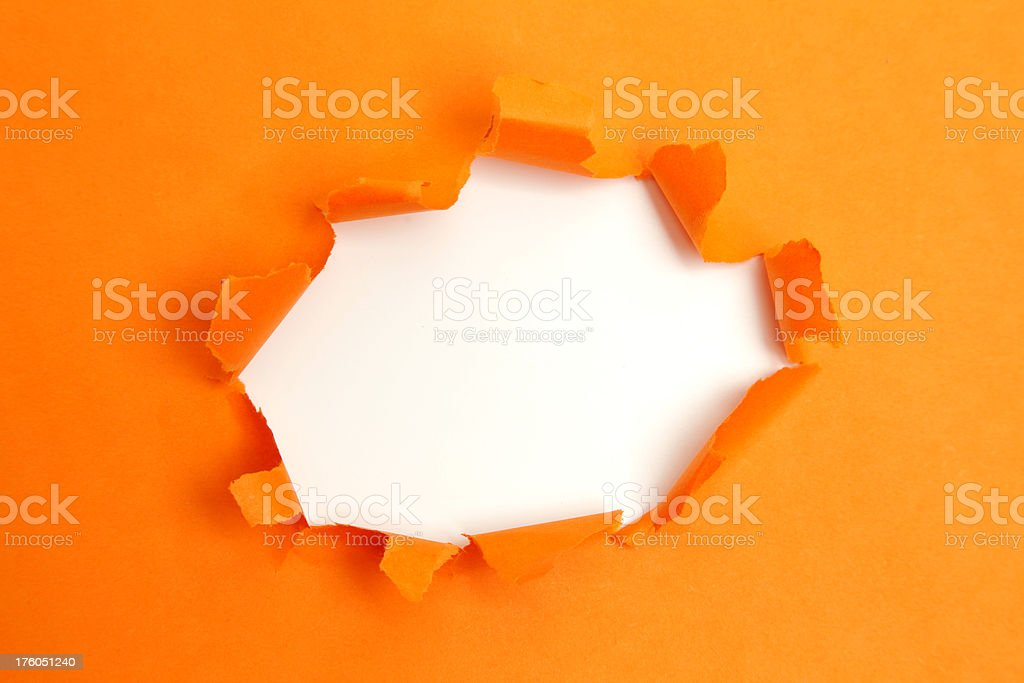 Orange paper hole stock photo