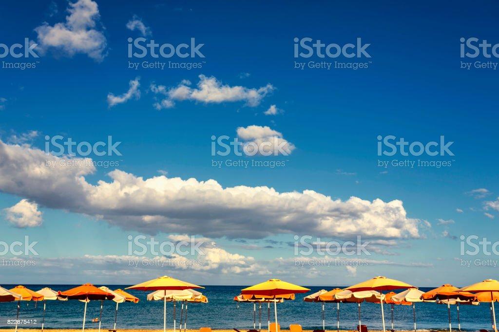 Orange parasols at Skala beach in Kefalonia stock photo