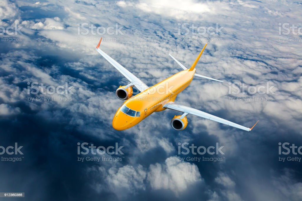 Orange passenger airplane in the sky. stock photo