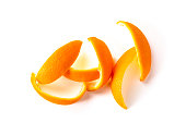 Pieces of orange peel isolated on white background, view from above