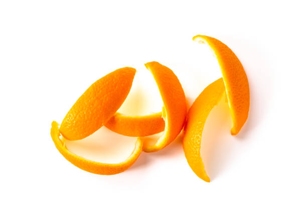 orange peel isolated on white background Pieces of orange peel isolated on white background, view from above peel plant part stock pictures, royalty-free photos & images