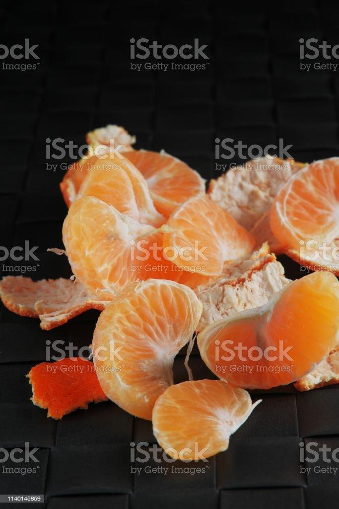 Orange peel mandarines on a dark background on a wooden table....