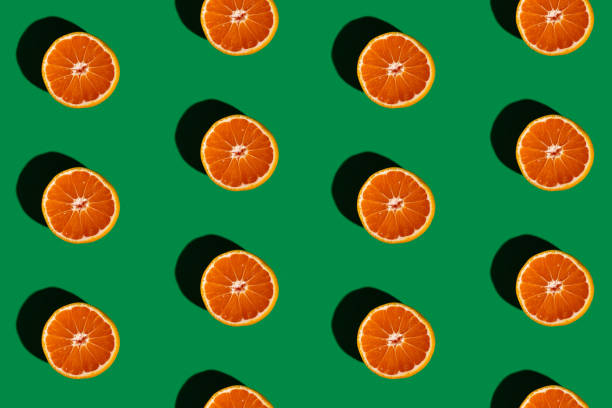 Orange composition of orange on a green background, still life stock pictures, royalty-free photos & images