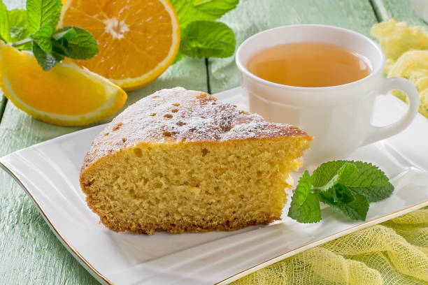 Orange pie and tea in a cup stock photo