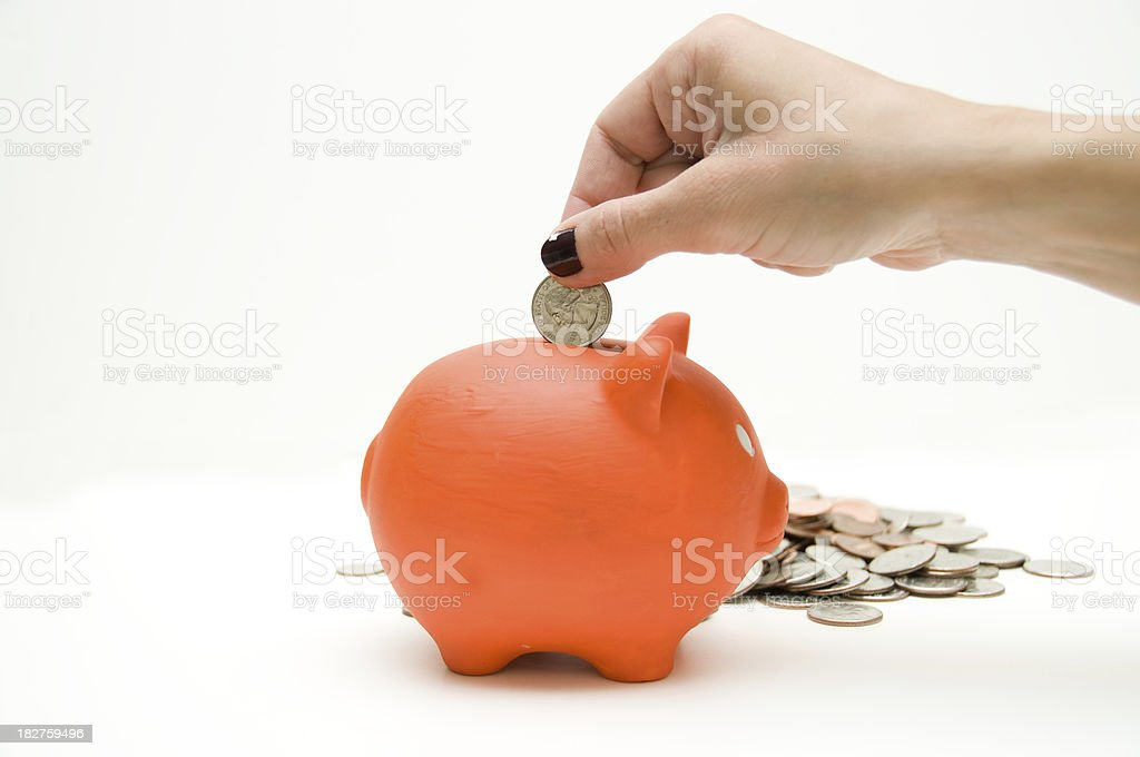 orange piggy bank and woman's hand royalty-free stock photo