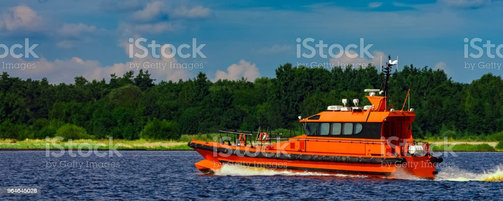 Orange pilot boat in action royalty-free stock photo