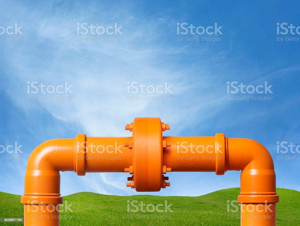 Orange Pipe in Field stock photo