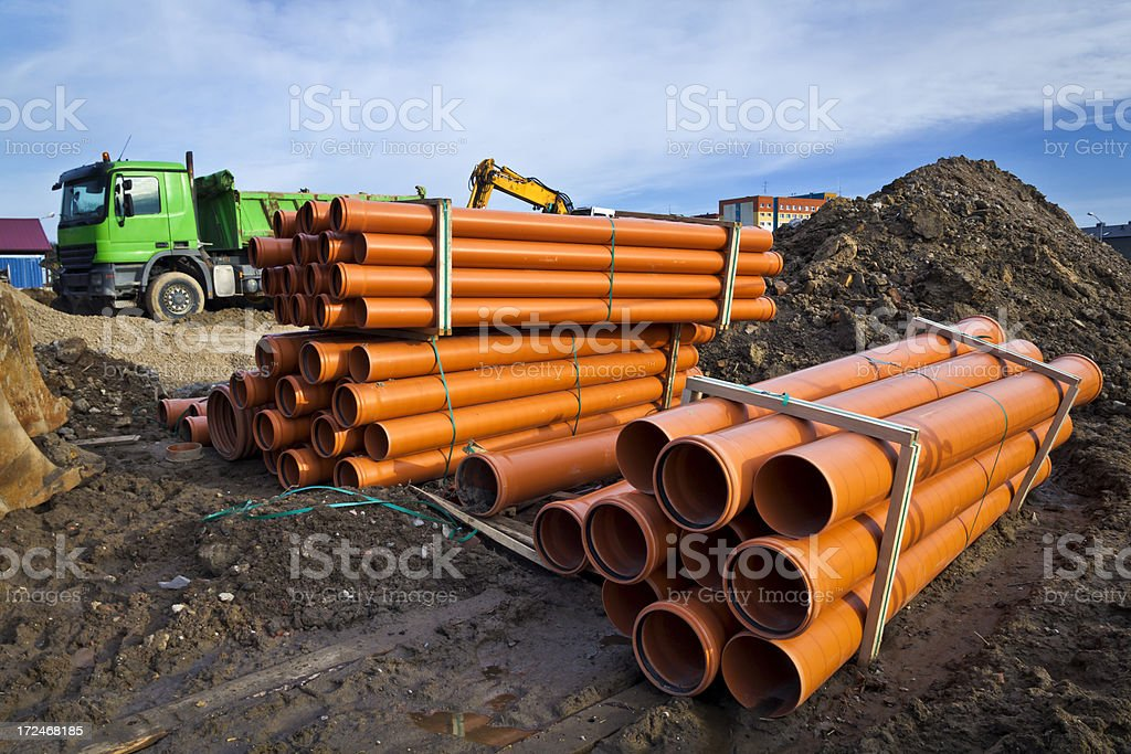 Orange pipes in construction site royalty-free stock photo