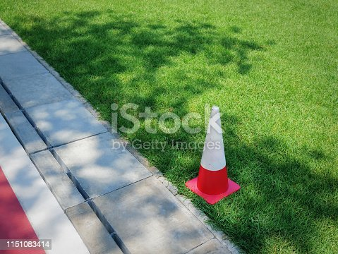 High Angle View of Orange Plastic Cone in Green Grass Soccer Field for Sport Training