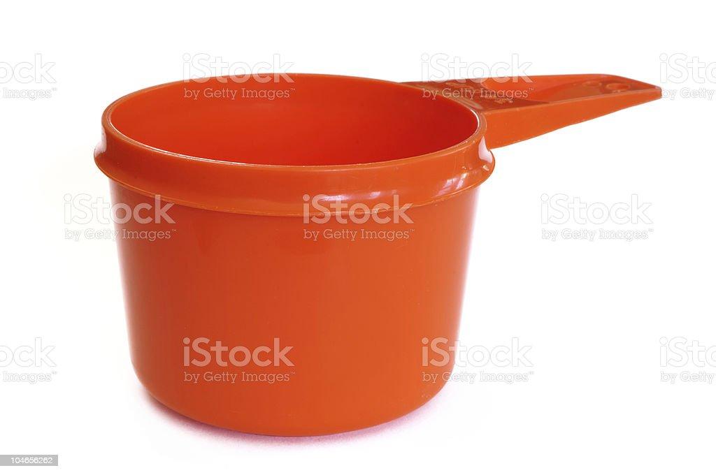 Orange Plastic Measuring Cup stock photo